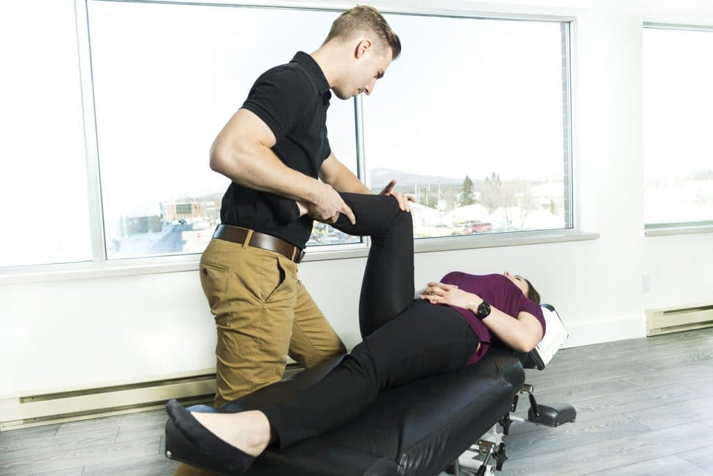 physical therapist adjusting for hip pain